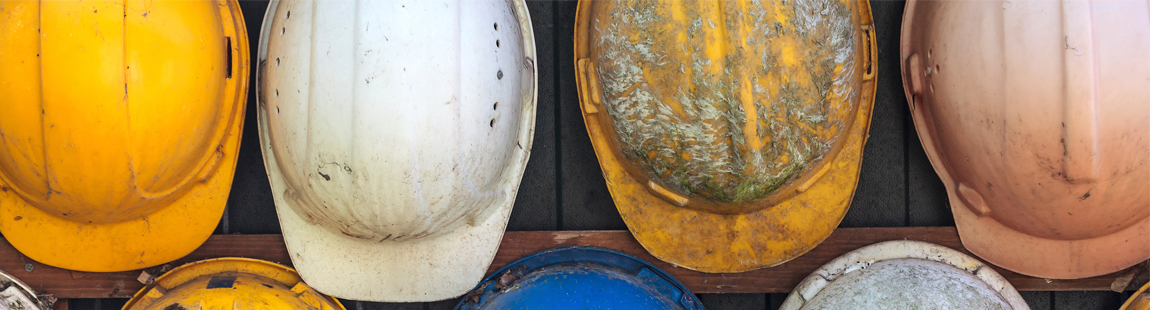 Image of hard hats for industries served by Compass Safety